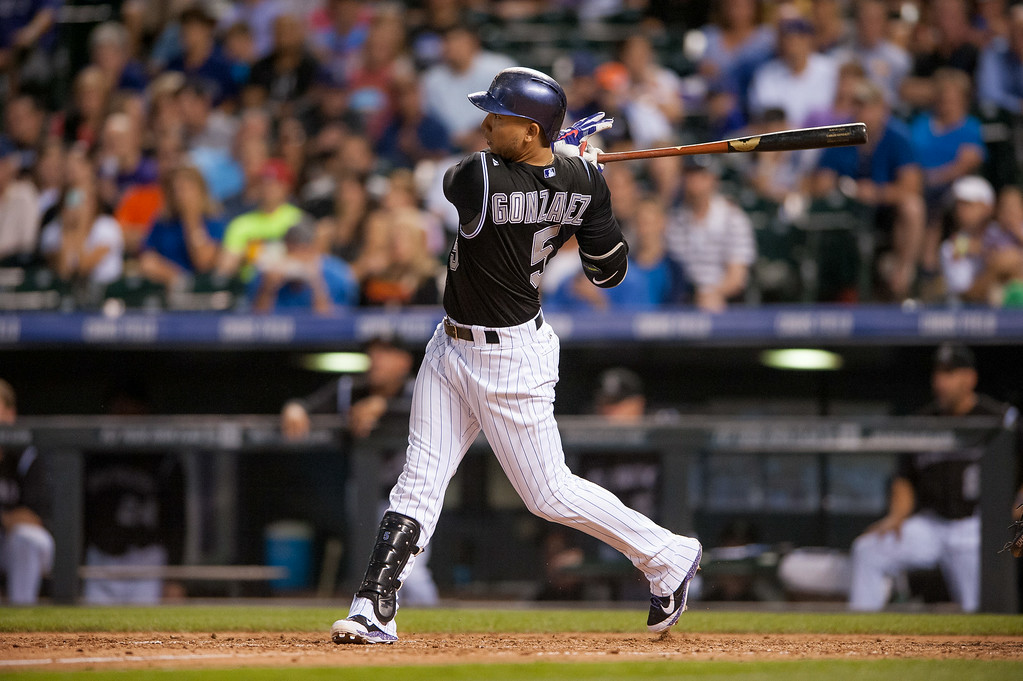 . DENVER, CO - AUGUST 06:  Carlos Gonzalez #5 of the Colorado Rockies hits a two run home run in the sixth inning of a game against the Chicago Cubs at Coors Field on August 6, 2014 in Denver, Colorado.  (Photo by Dustin Bradford/Getty Images)