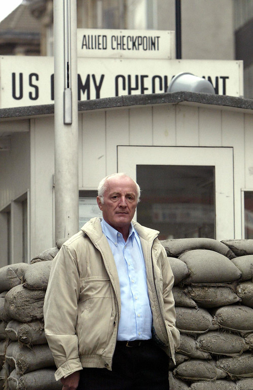 . Former Stasi (east German secret police) officer Hagen Koch stands at Checkpoint Charlie on Berlin\'s Friedrichstrasse, 27 October 2004. Koch was responsible on 13 August 1961 of tracing the outline of what would become known as the Berlin wall, which separated the Russian sector of the city from the western sectors. (Photo credit JOHN MACDOUGALL/AFP/Getty Images)