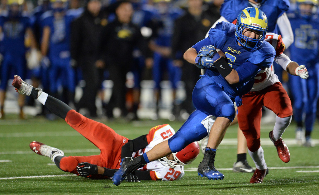 . San Dimas\' Fausto Martinez (5) runs past the Paraclete defense in the second half of a CIF-SS Mid-Valley Division championship football game at San Dimas High School in San Dimas, Calif., on Friday, Dec. 6, 2013. San Dimas won 20-14.  (Keith Birmingham Pasadena Star-News)