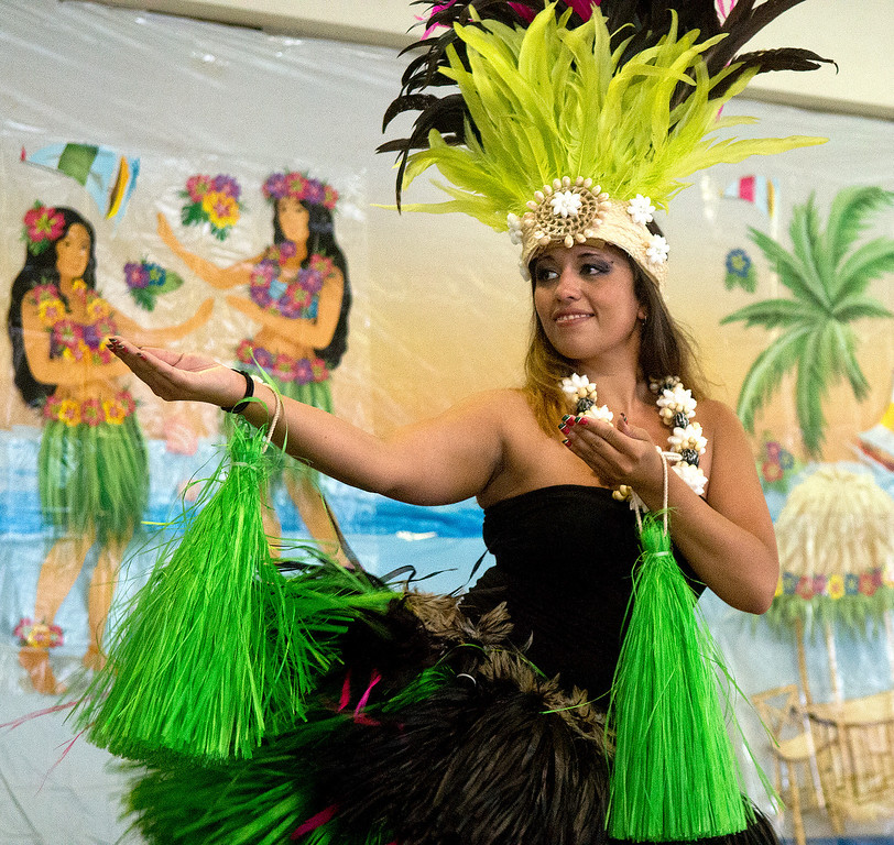 . Duncan Scott/DScott@News-Herald.com Jessica Wiener of Ohana Aloha perfroms a hula dance during a luau at the Lake County Board of Developmental Disabilities/Deepwood Vocational Guidance Center.