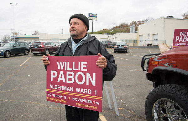 11/05/19 Wesley Bunnell | StaffrrAlderman Willie Pabon holds his campaign sign at the VFW 511 voting location early Tuesday afternoon.