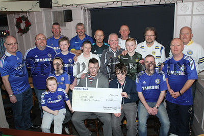Newry Chelsea & Leeds UTD Supporters Clubs Annual Charity Football Match played in August present a Cheque for£500 to Lupus Uk, Presented to Miceal and Aaron McParland by Aoibh McMahon