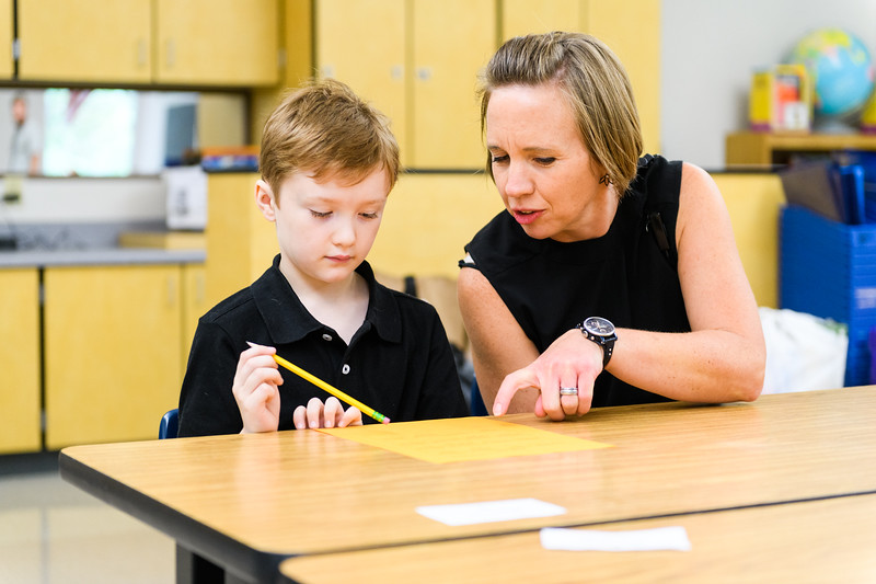Hallman principal Jessica Brenden helps a student with his classroom activity. Back to school day at Hallman Elementary School on Wednesday, September 4, 2019 in Salem, Ore.