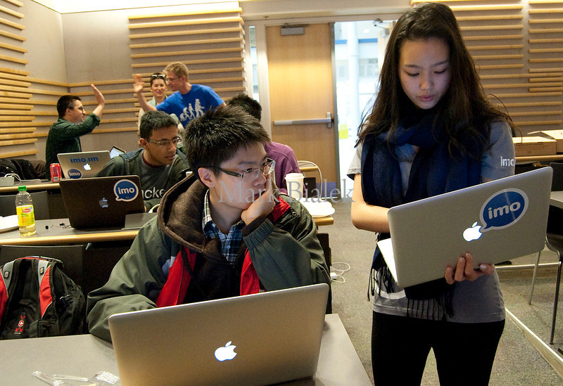 University of Michigan student Kevin Soong gets help preparing his app presentation from imo.im employee Lorraine Lee during a 22-hour 'Hackathon' on the University of Michigan's North Campus on Jan 19, 2013.  The event sponsor, Silicon Valley startup imo.im, is looking for talent for its growing online business.  http://blog.imo.im/2013/01/imo-spends-weekend-in-michigan-for.html