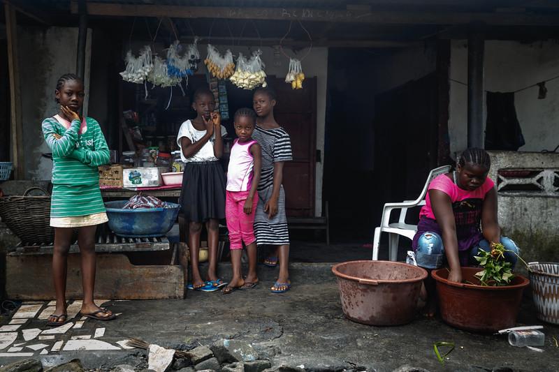 Monrovia, Liberia October 6, 2017 - Girls standing in front of a neighborhood store.