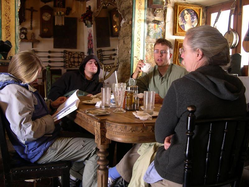 Typical cafe scene, Kjirsten plans the next adventure and Derek sleeps.