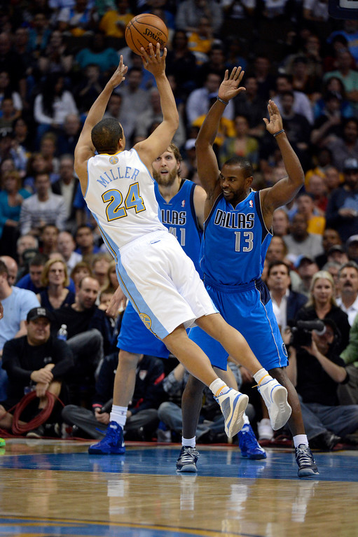 . DENVER, CO. - APRIL 04: Andre Miller (24) of the Denver Nuggets takes an off balance shot over Mike James (13) of the Dallas Mavericks during the fourth quarter April 4,  2013 at Pepsi Center. (Photo By John Leyba/The Denver Post)