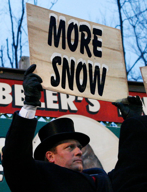 . Inner Circle member Keith Shields holds a sign after Punxsutawney Phil, the weather prognosticating groundhog emerged from his burrow on Gobblers Knob in Punxsutawney, Pa., to see his shadow and forecast six more weeks of winter weather Tuesday, Feb. 2, 2010.  (AP Photo/Gene J. Puskar)