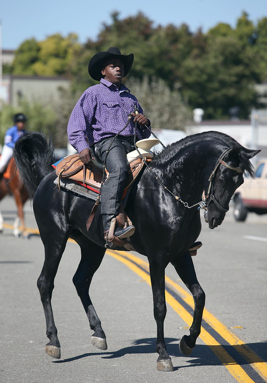 . J.R. Ragsdale, of Sacramento, rides during the 39th annual Oakland Black Cowboy Parade and Heritage Festival in Oakland, Calif., on Saturday, Oct. 5, 2013. The event also featured food, entertainment and pony rides for kids at De Fremery Park. The Oakland Black Cowboy Association began in 1975 and educates the public about the role that black cowboys played in history and building of the west. (Jane Tyska//Bay Area News Group)