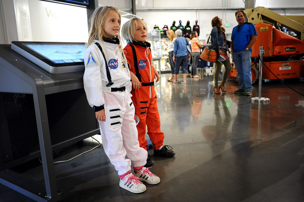 ". Andre and Victoria George pose for photos while wearing astronaut attire during their visit to the space shuttle Endeavour at the California Science Center in Los Angeles, CA October 11, 2013.   In honor of Endeavour\'s 1st year in Los Angeles, the museum is holding ""Endeavour Fest\"" beginning today (Oct. 11) and running through Sunday with special exhibits and astronaut guest speakers scheduled.(Andy Holzman/Los Angeles Daily News)"