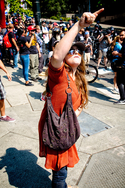 """This right wing supporter was in near constant yell mode with counterprotesters. When I heard her screaming about """"freedom of speech"""" I could only think about Trump's attempt to silence Ex-CIA director John Brennan by revoking his security clearance."""