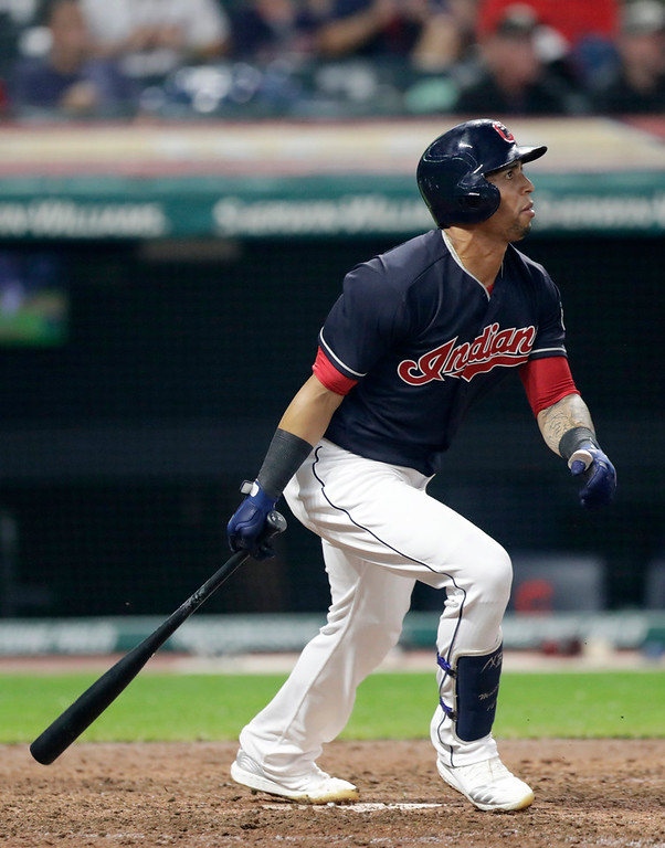. Cleveland Indians\' Leonys Martin watches his sacrifice fly in the eighth inning of a baseball game against the Minnesota Twins, Tuesday, Aug. 7, 2018, in Cleveland. Michael Brantley scored on the play. (AP Photo/Tony Dejak)