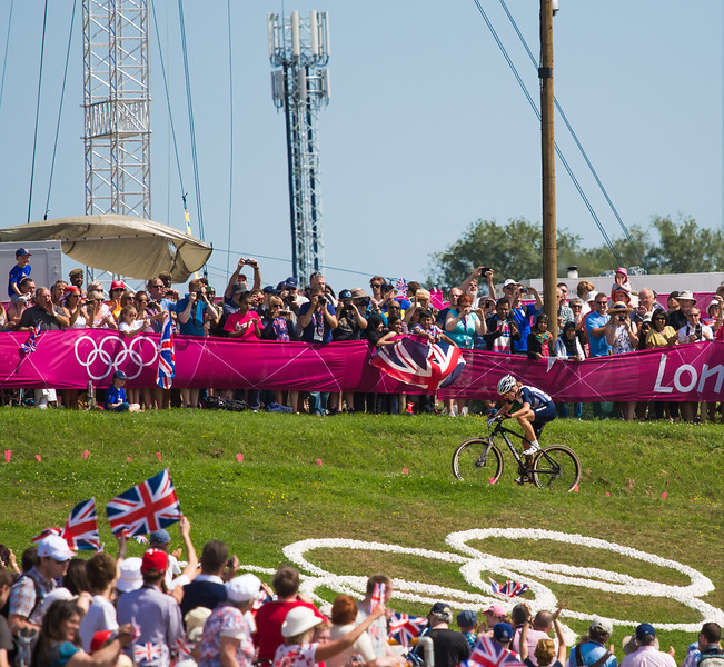 Annie Last finishes over the olympic rings