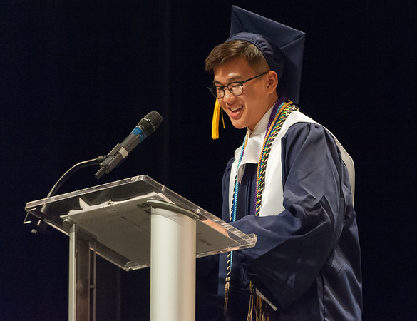 06/21/18 Wesley Bunnell | Staff Newington High School 2018 Valedictorian Khang Nguyen gives his address during the school's commencement ceremony at The Oakdale Theatre on Thursday evening.