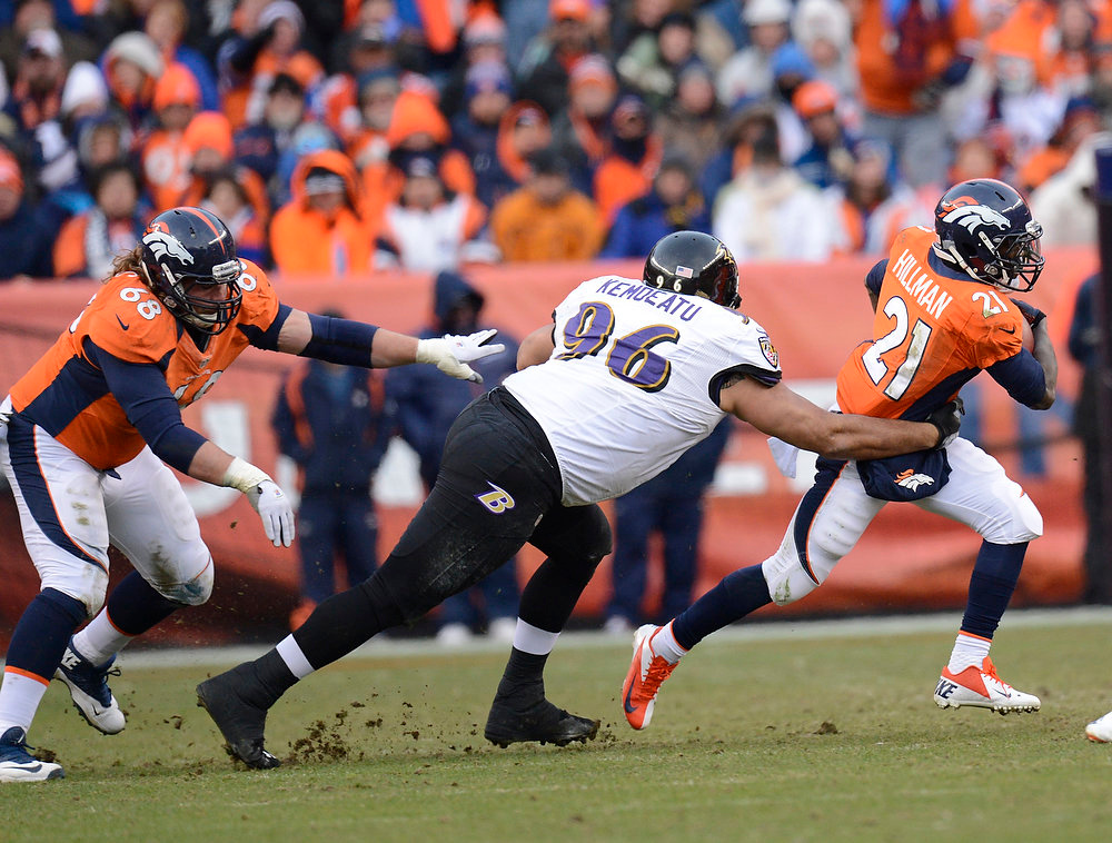 Description of . Denver Broncos running back Ronnie Hillman (21) makes a run in the second quarter. The Denver Broncos vs Baltimore Ravens AFC Divisional playoff game at Sports Authority Field Saturday January 12, 2013. (Photo by Joe Amon,/The Denver Post)