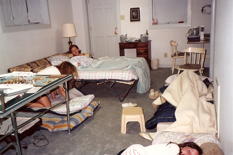 Edward, Catherine , Anne and Lauren making their beds in the basement  - Lauren is under the quilt 6/90