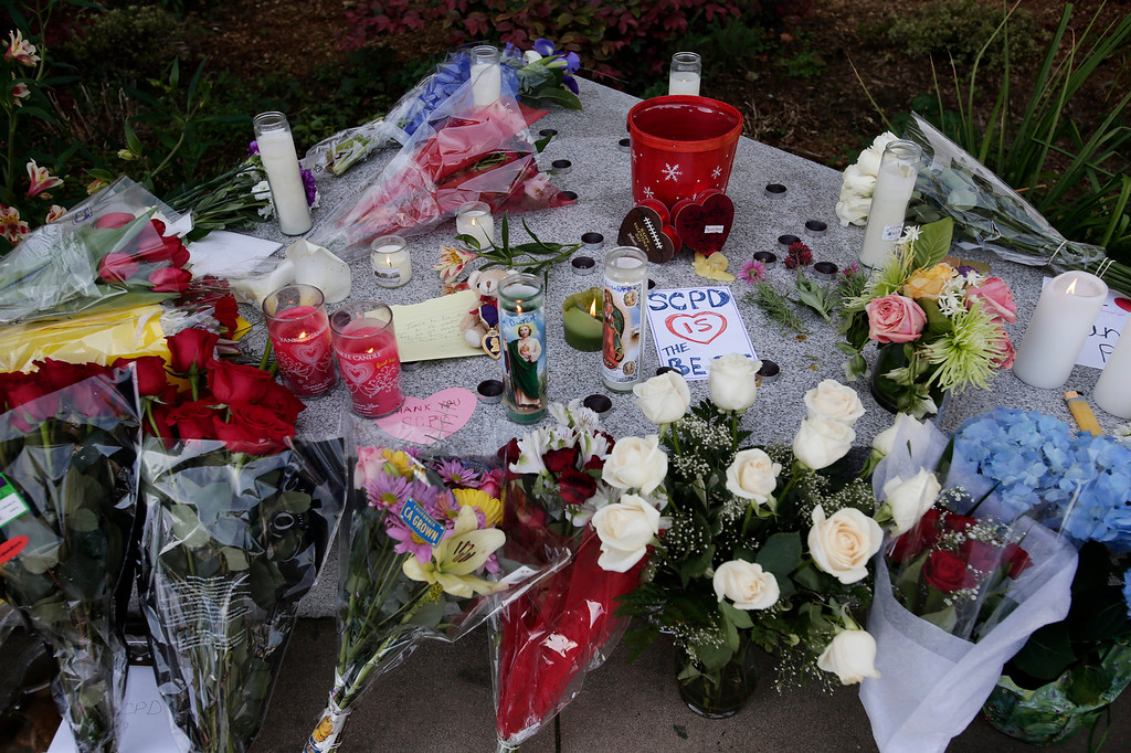 ". A makeshift memorial for slain Santa Cruz police officers, detective <a href=""http://www.santacruzsentinel.com/localnews/ci_22676928/loran-butch-baker-28-year-veteran-leaves-legacy\"">Sgt. Loran \""Butch\"" Baker</a> and detective <a href=\""http://www.santacruzsentinel.com/localnews/ci_22676931/santa-cruz-police-detective-elizabeth-butler-policing-was\"">Elizabeth Butler</a> in front of the police department in Santa Cruz, Calif. on Wednesday, Feb. 27, 2013. The pair were <a href=\""http://www.santacruzsentinel.com/localnews/ci_22674808/breaking-2-officers-1-suspect-shot-santa-cruz\"">gunned down yesterday</a while investigating a possible domestic violence or sexual assault when a suspect fired at them. The gunman, Jeremy Peter Goulet, was later gunned down when he exchanged gunfire with police during a manhunt. (Gary Reyes/ Staff)"