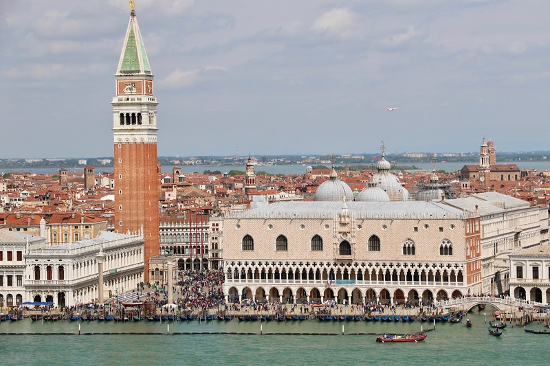 St. Mark's Bell Tower looming above Doge's Palace to its right
