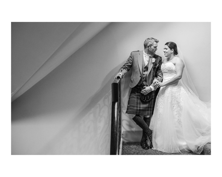Wedding Photography of Louise & Jason, Dunfries arms Hotel, Scotland, Photograph is of the Bride & Groom standing on the hotel stairs