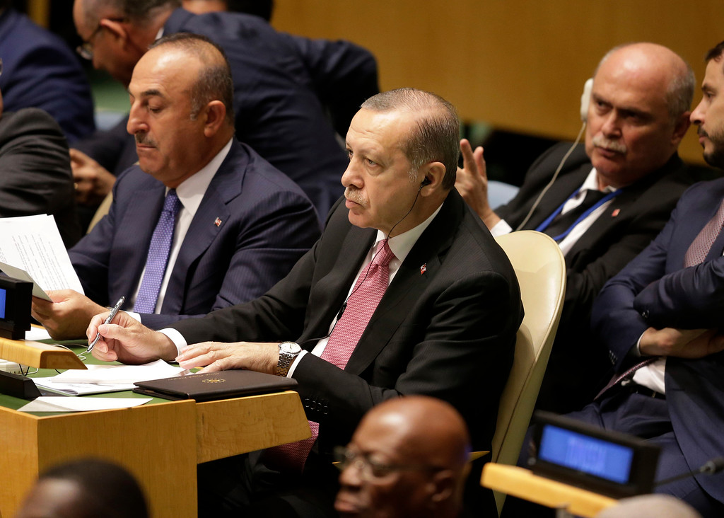 . Turkish President Recep Tayyip Erdogan watches as United States President Donald Trump speaks during the United Nations General Assembly at U.N. headquarters, Tuesday, Sept. 19, 2017. (AP Photo/Seth Wenig)