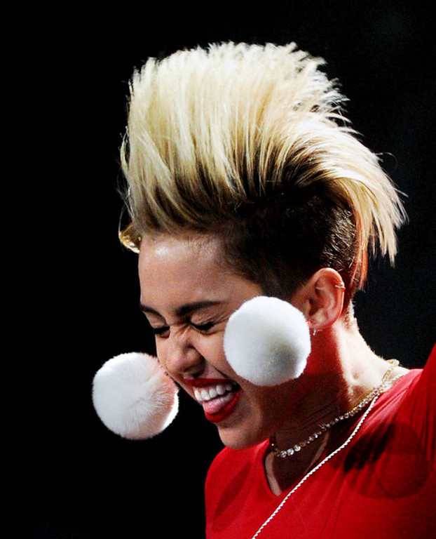 ". Miley Cyrus flings back her bleached hair as she performs ""Party in the USA\""  at Xcel Energy Center in St. Paul, Tuesday, December 10, 2013. (Pioneer Press: Chris Polydoroff)"