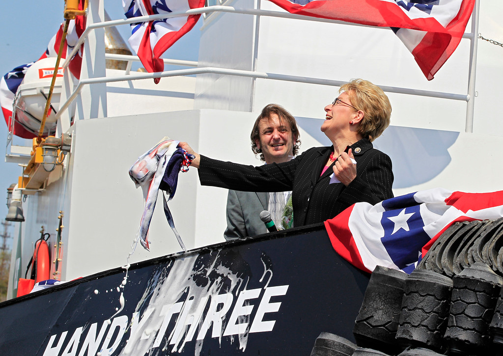 """. U.S. Rep. Marcy Kaptur, D-Ohio, right, reacts with Great Lakes Shipbuilding vice-president of operations Gregg Thauvette after christening the tug \""""Handy Three\"""" in Cleveland Wednesday, May 2, 2012. The 74-foot offshore/harbor tug has been sold to Puerto Rico Towing & Barge Co. of San Juan, Puerto Rico. (AP Photo/Mark Duncan)"""