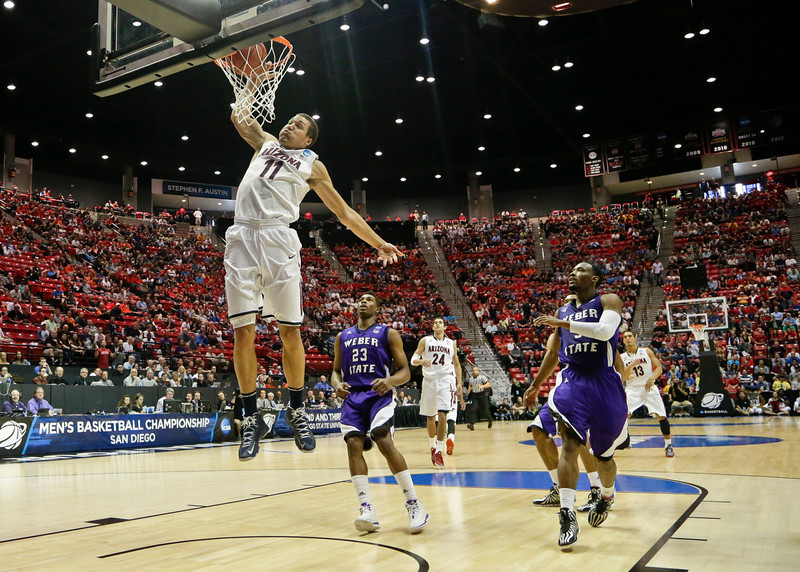 . Arizona forward Aaron Gordon slams in a basket against Weber State during the first half in a second-round game in the NCAA college basketball tournament Friday, March 21, 2014, in San Diego. (AP Photo/Gregory Bull)