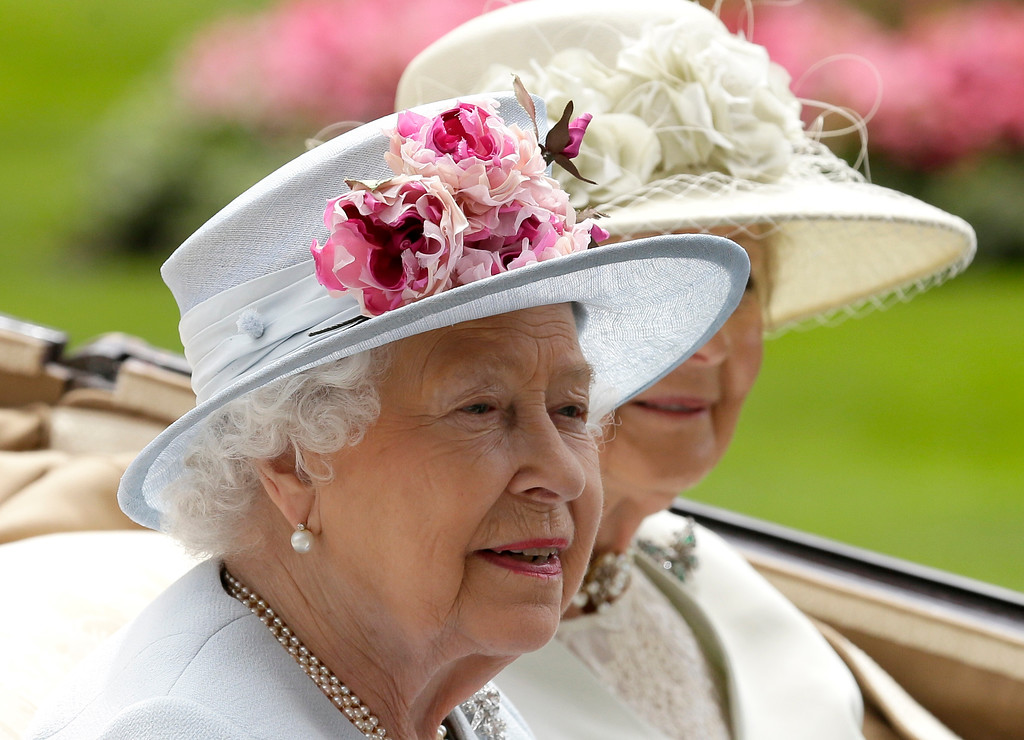. Britain\'s Queen Elizabeth II arrives at the parade ring with Princess Alexandra in a horse drawn carriage, on the second day of the Royal Ascot horse race meeting in Ascot, England, Wednesday, June 20, 2018. (AP Photo/Tim Ireland)