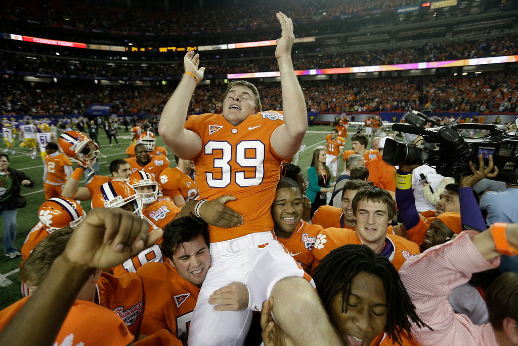 . Clemson kicker Chandler Catanzaro (39) is hoisted into the air after he kicked the winning 37-yard field goal after the second half of the Chick-fil-A Bowl NCAA college football game against LSU, Monday, Dec. 31, 2012, in Atlanta. Clemson won 25-24.  (AP Photo/David Goldman)