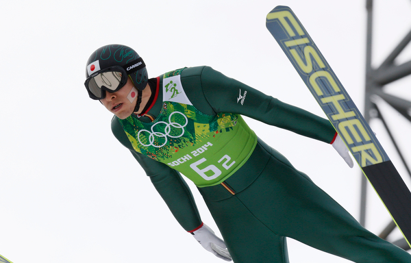 . Japan\'s Yusuke Minato makes an attempt during the ski jumping portion of the Nordic combined Gundersen large hill team competition at the 2014 Winter Olympics, Thursday, Feb. 20, 2014, in Krasnaya Polyana, Russia. (AP Photo/Dmitry Lovetsky)