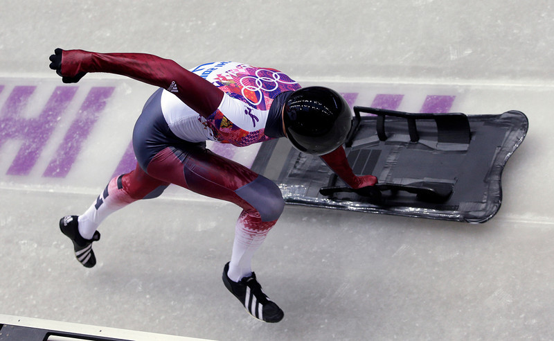 . Tomass Dukurs of Latvia starts his first run during the men\'s skeleton competition at the 2014 Winter Olympics, Friday, Feb. 14, 2014, in Krasnaya Polyana, Russia. (AP Photo/Michael Sohn)