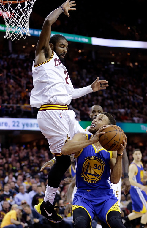 . Cleveland Cavaliers guard Kyrie Irving, left, defends Golden State Warriors guard Stephen Curry (30) during the first half of Game 3 of basketball\'s NBA Finals in Cleveland, Wednesday, June 7, 2017. (AP Photo/Tony Dejak)