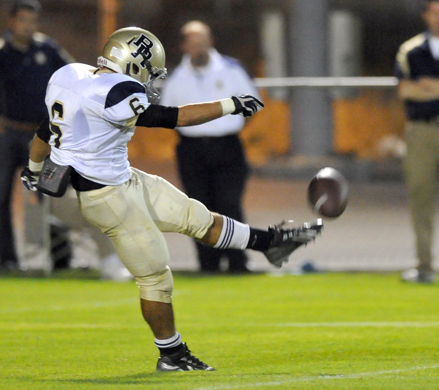 . Rowland\'s Brandon Baisley (#6) punts the ball as they play Northview in their non-league game at Covina District Field in Covina on Friday September 13, 2013. Northview beat Rowland 28-0. (San Gabriel Valley Tribune/Staff Photo by Keith Durflinger)