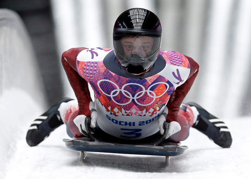 . Martins Dukurs of Latvia crosses into the finish area to win the silver medal during the men\'s skeleton competition at the 2014 Winter Olympics, Saturday, Feb. 15, 2014, in Krasnaya Polyana, Russia. (AP Photo/Natacha Pisarenko)