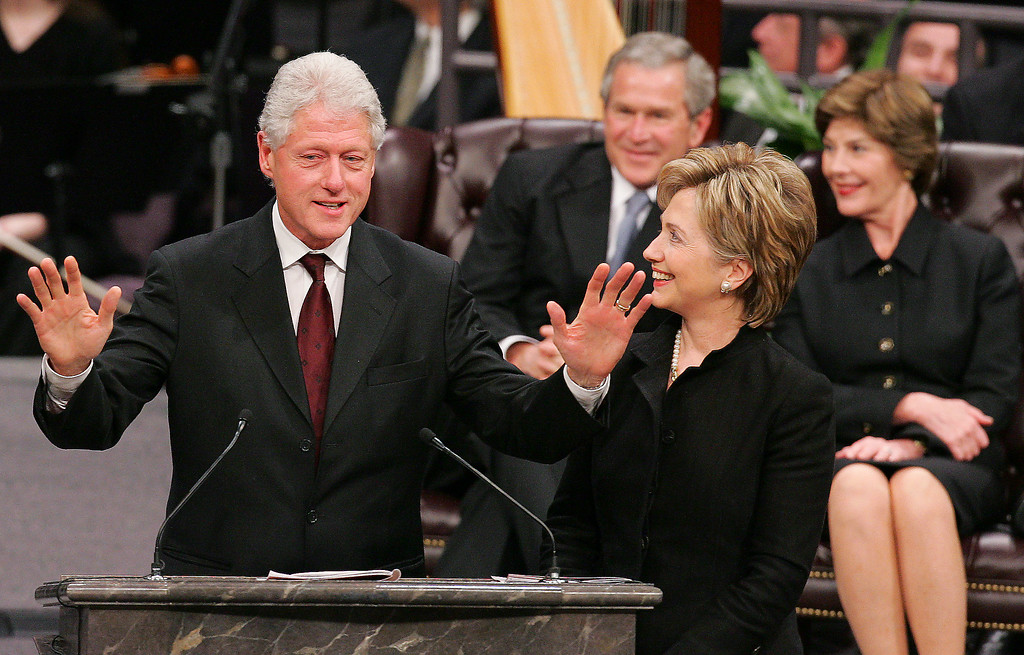 . Former Pres. Bill Clinton addresses those gathered at the Coretta Scott King funeral ceremony at the New Birth Missionary Baptist Church in Lithonia, Ga. Tuesday, Feb. 7, 2006. With Clinton, is his wife, US Sen. Hillary Clinton, D-NY. At rear is Pres. Bush and First Lady Laura Bush. (AP Photo/Ric Feld, Pool)
