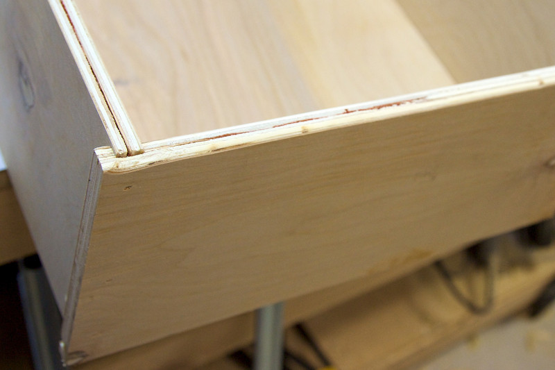 Grooves hold the back of the drawer in place.