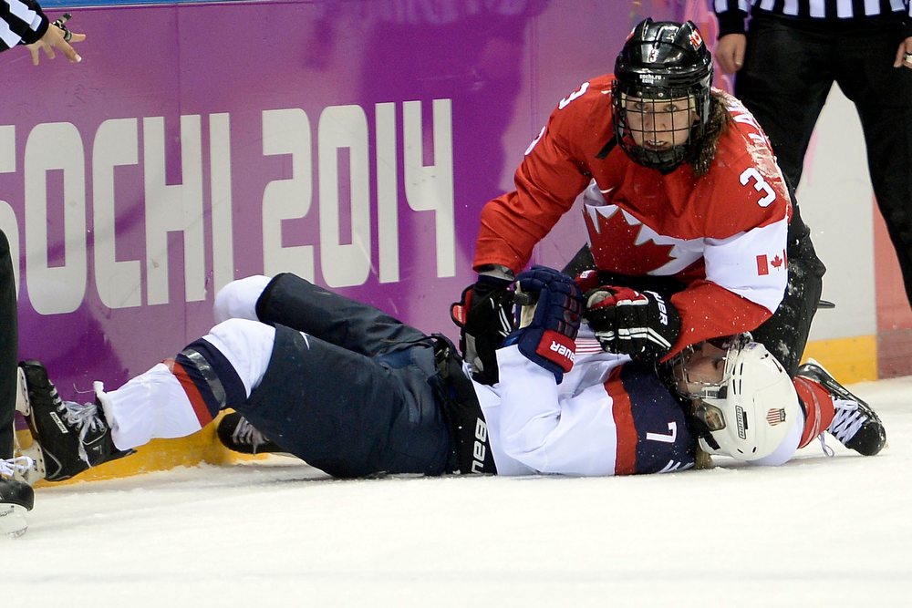 . Jocelyne Larocque (3) of the Canada checks Monique Lamoureaux (7) of the U.S.A. during the first period of the women\'s gold medal ice hockey game. Sochi 2014 Winter Olympics on Thursday, February 20, 2014 at Bolshoy Ice Arena. (Photo by AAron Ontiveroz/ The Denver Post)