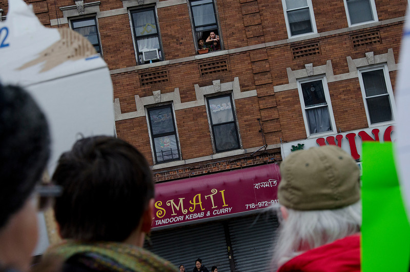 Residents listened to speakers from their apartment windows.