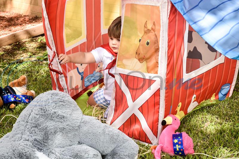 Walt Eagleton, 2, plays in a toy barn during the Kids Kaleidoscope Preschool Toddler Fair at Pollard United Methodist Church in Tyler, Texas, on Thursday, Oct. 4, 2018. (Chelsea Purgahn/Tyler Morning Telegraph)
