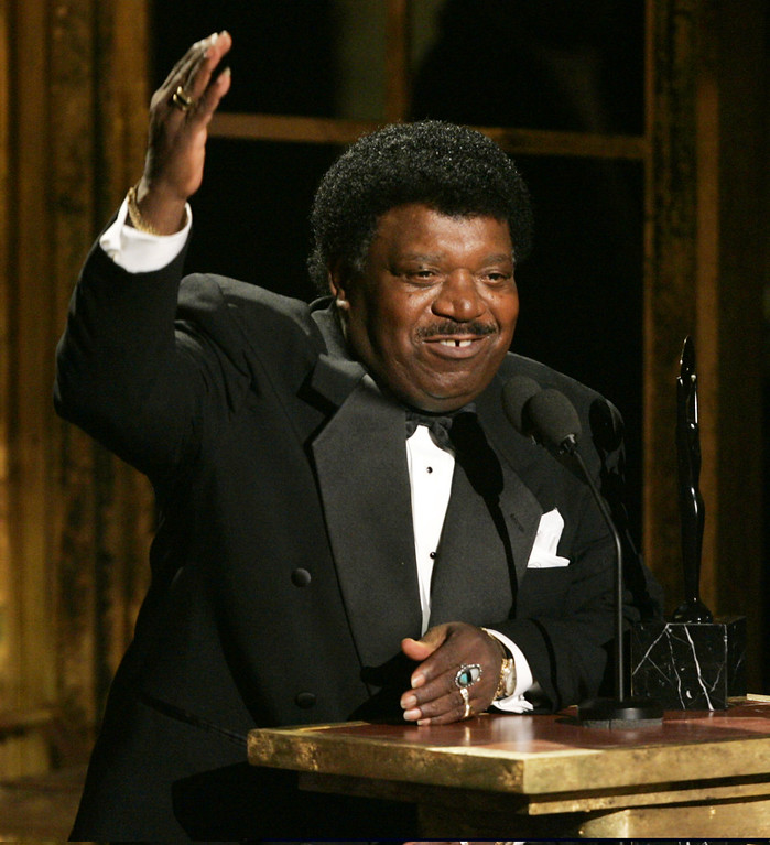 """. FILE - In this March 14, 2005 file photo, Percy Sledge accepts his award during the Rock and Roll Hall of Fame induction ceremony in New York. Sledge, who recorded the classic 1966 soul ballad \""""When a Man Loves a Woman,\"""" died, Tuesday April 14, 2015. He was 73. (AP Photo/Julie Jacobson, File)"""