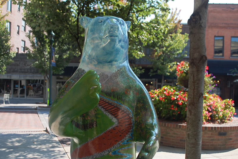 a bear sculpture on a town square in Hendersonville, North Carolina