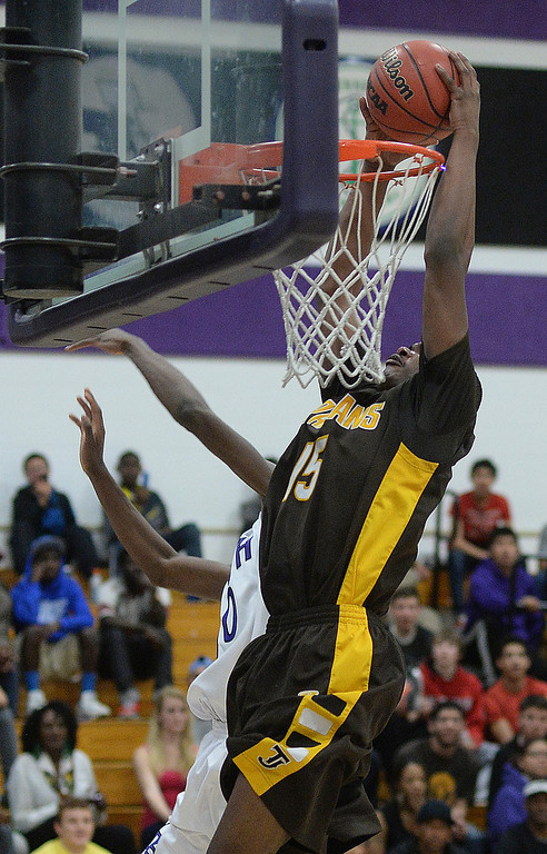 . Spartans\' senior Treyvon Andres (15) slammed down two points in the first half.   Photo By Karl Gehring/The Denver Post
