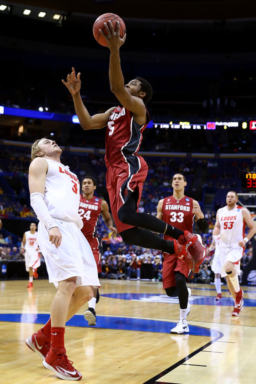 . Chasson Randle #5 of the Stanford Cardinal shoots the ball against Hugh Greenwood #3 of the New Mexico Lobos during the second round of the 2014 NCAA Men\'s Basketball Tournament at Scottrade Center on March 21, 2014 in St Louis, Missouri.  (Photo by Andy Lyons/Getty Images)