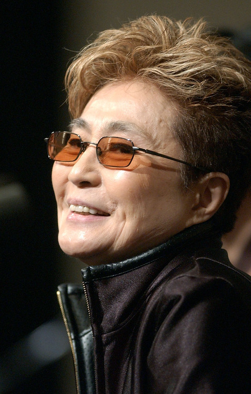 """. Artist Yoko Ono speaks at a news conference regarding her show \""""Yes Yoko Ono\"""" at the San Francisco Museum of Modern Art, Friday, June 21, 2002, in San Francisco. The show is the first American retrospective of Ono\'s work and will be open to the public June 22 and run until Sept. 8. (AP Photo/Justin Sullivan)"""