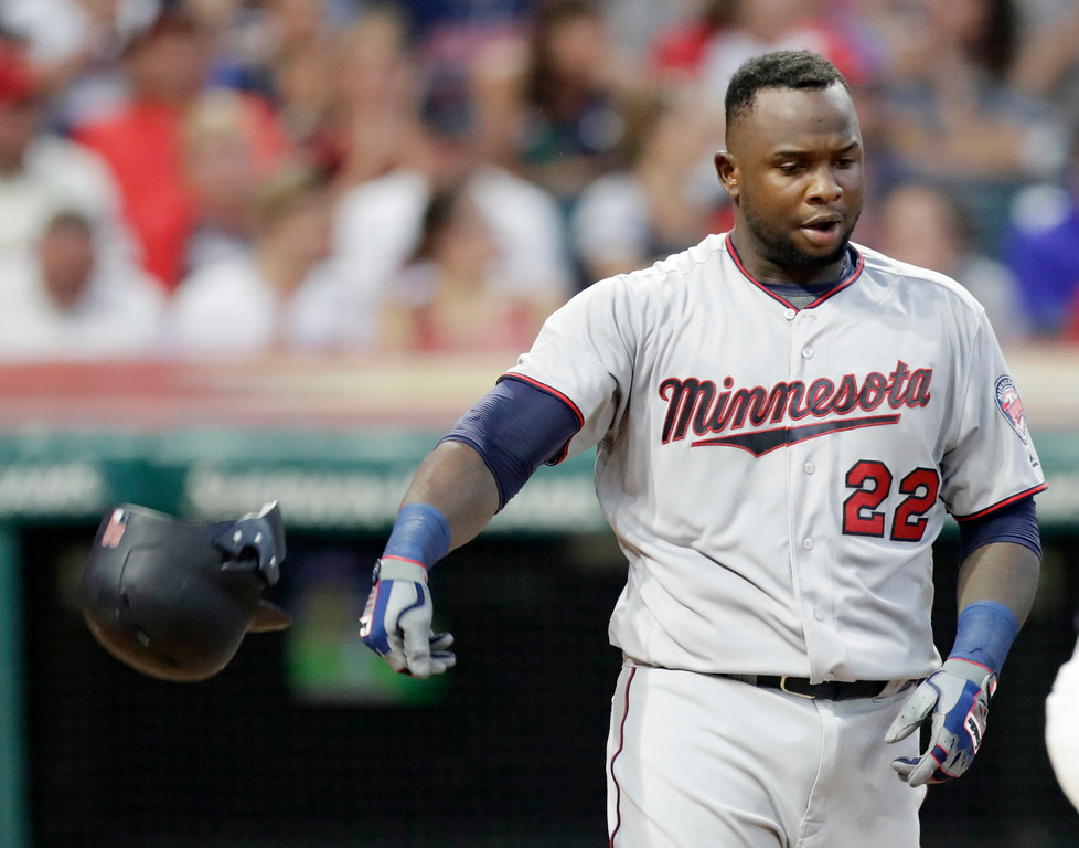 . Minnesota Twins\' Miguel Sano throws his helmet after striking out against Cleveland Indians starting pitcher Adam Plutko in the third inning of a baseball game Wednesday, Aug. 29, 2018, in Cleveland. (AP Photo/Tony Dejak)