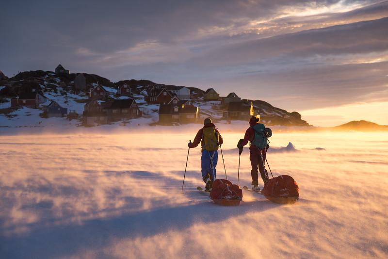 Dragging pulks back to Kulusuk at sunset, East Greenland
