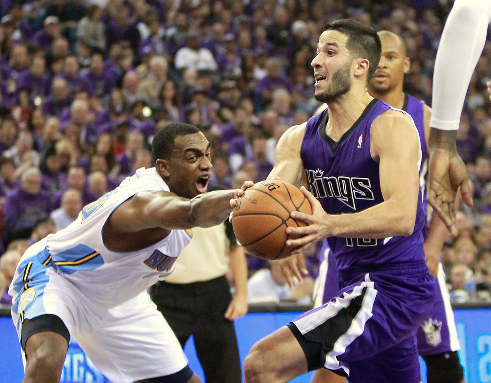 . Denver Nuggets forward Darrell Arthur, left, knocks the ball out of the hand of Sacramento Kings guard Greivis Vasquez, of Venezuela, during the fourth quarter of an NBA basketball game in Sacramento, Calif., Wednesday, Oct. 30, 2013. The Kings won 90-88. (AP Photo/Rich Pedroncelli)
