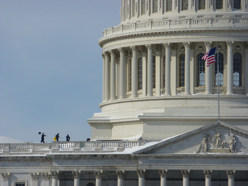 Shoveling the roof of the Capitol