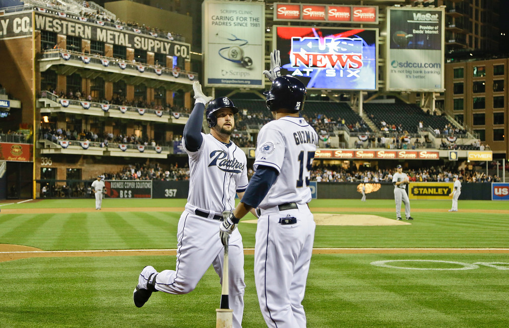 . San Diego Padres\' Yonder Alonso is congratulated by Jesus Guzman (15) after his two-run homer against the Colorado Rockies during the first inning of a baseball game, Friday, April 12, 2013, in San Diego. (AP photo/Lenny Ignelzi)
