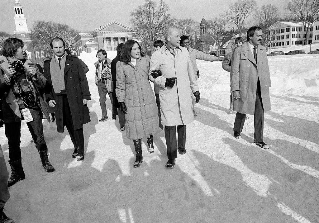 . Democratic presidential hopeful Sen. John Glenn of Ohio walks with his daughter Lyn through the Dartmouth Green prior to the Democratic presidential debate at Dartmouth College in Hanover, N.H., Jan. 15, 1984. All eight Democratic presidential hopefuls will be on stage together for the first time in 1984. (AP Photo/Jim Cole)